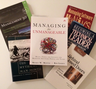 Photo of books that provide training for development managers.