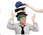 How can you choose the most appropriate job title when wearing many 'hats' in your company?